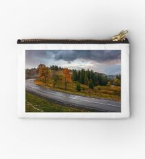 countryside road through forest in stormy weather Studio Pouch