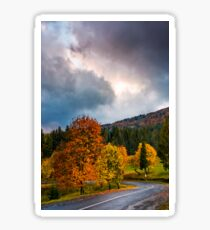 gorgeous cloudy sky over colorful foliage on serpentine Sticker
