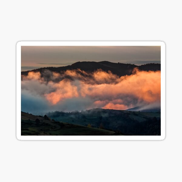 rising clouds in mountainous countryside at sunrise Sticker