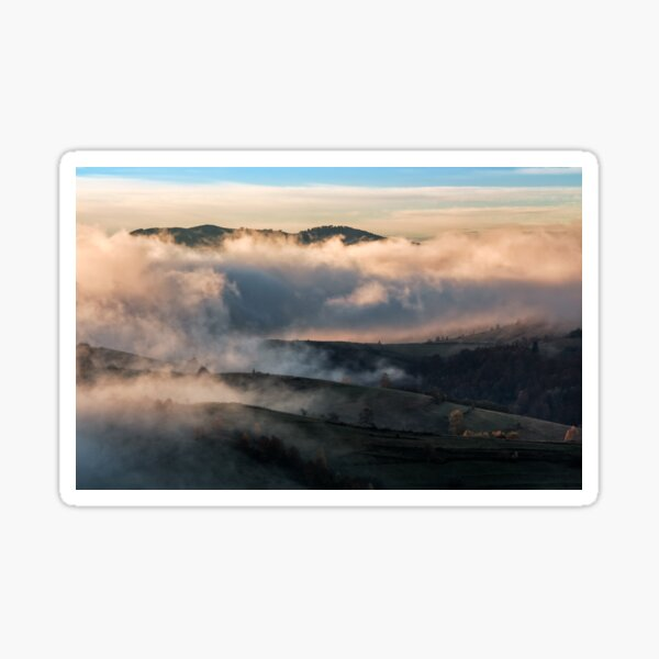 clouds and fog rising over countryside Sticker