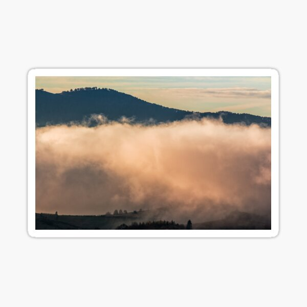 huge cloud in morning light over the valley Sticker