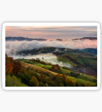 rising cloud covers rural fields in mountains Sticker
