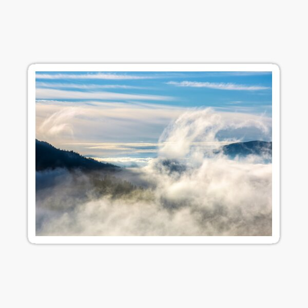 thick cloud formation rising from the valley Sticker