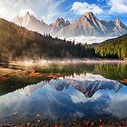gorgeous mountain lake in autumn fog by mike-pellinni