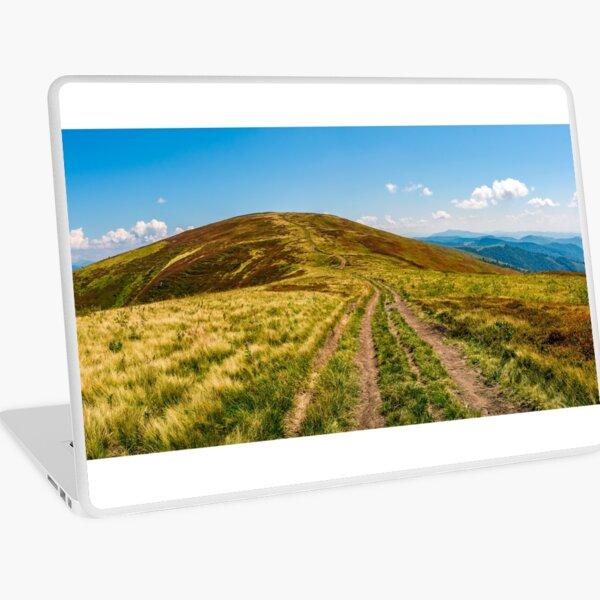 panorama with dirt road through mountain ridge Laptop Skin