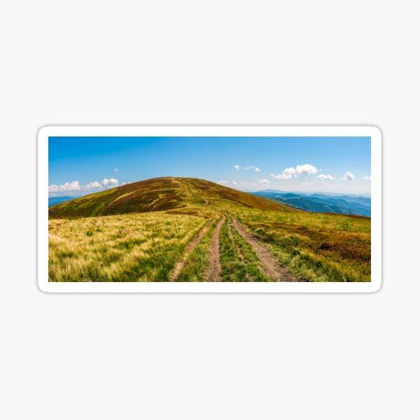 panorama with dirt road through mountain ridge Sticker