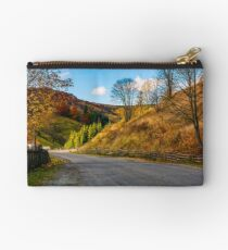 fences along the road in picturesque rural area Studio Pouch
