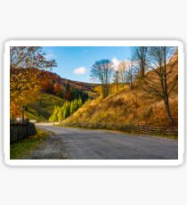 fences along the road in picturesque rural area Sticker