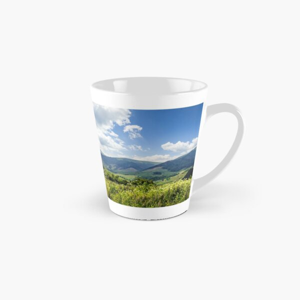 meadow with flowers in mountains Tall Mug
