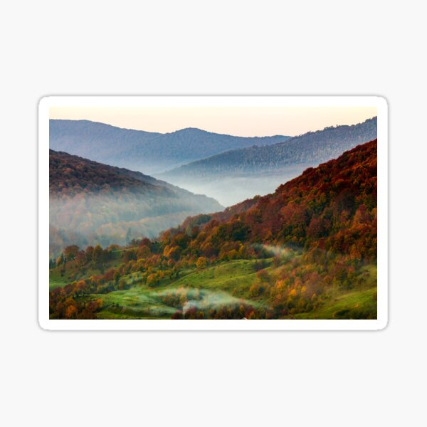 cold fog on hot sunrise in mountains Sticker