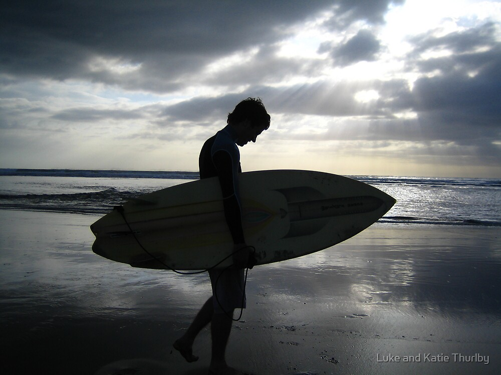 Surfer at sunset by Luke and Katie Thurlby