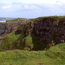NI - NorthEast coastline ... looking toward Dunluce Castle ruins by SNAPPYDAVE