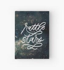 Rasseln Sie die Sterne Notizbuch