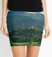 Afternoon light over church Mini Skirt