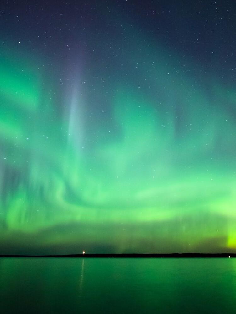 Northern lights over lake by Juhku