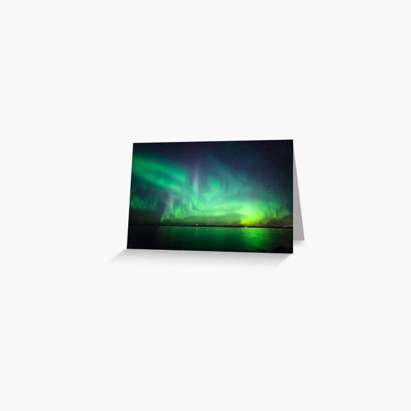 Northern lights over lake Greeting Card