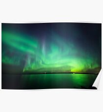 Northern lights over lake Poster