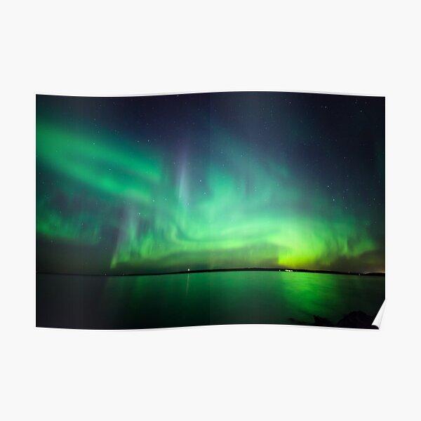 Northern lights over lake Poster