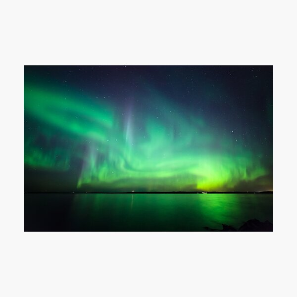 Northern lights over lake Photographic Print