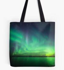 Northern lights over lake Tote Bag