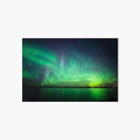 Northern lights over lake Art Board Print