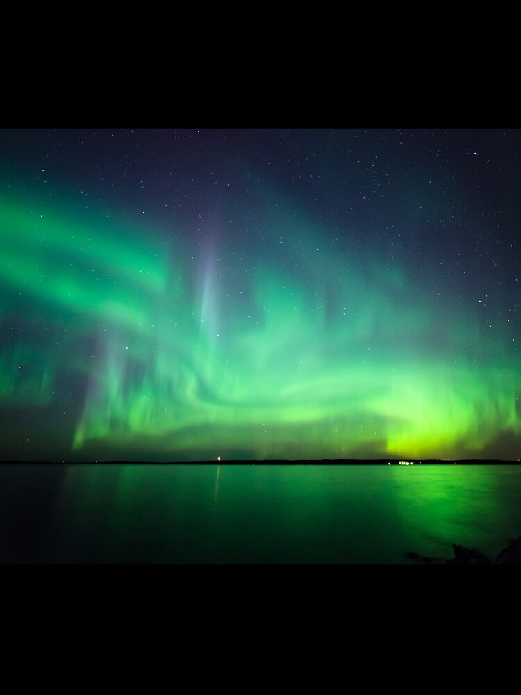 Northern lights over lake by Juhku