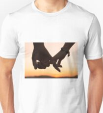 Holding hands in the sunset T-Shirt