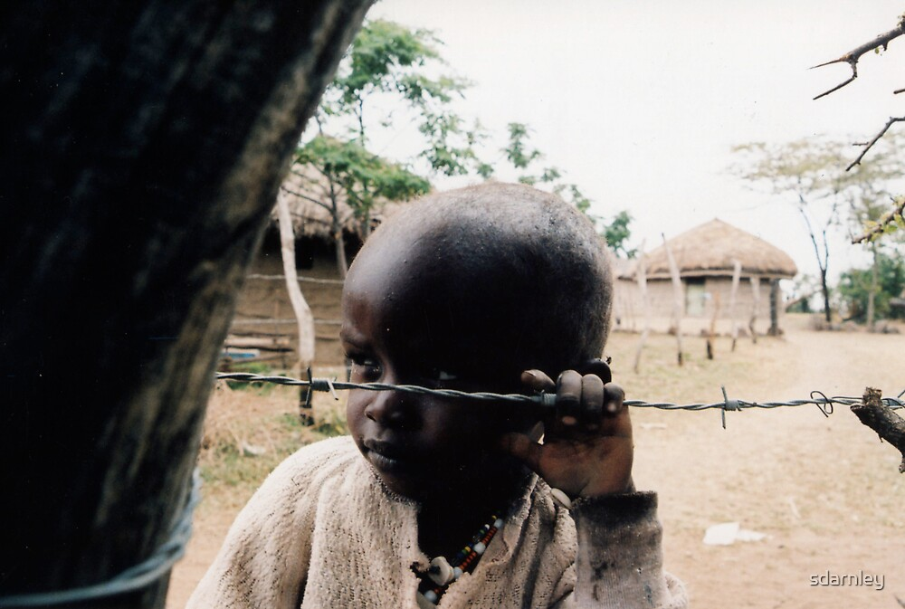 Boy behind wire by sdarnley