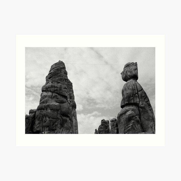 Climbing the rocks Art Print