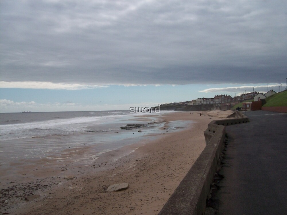 The beach at Whitley Bay England by sword