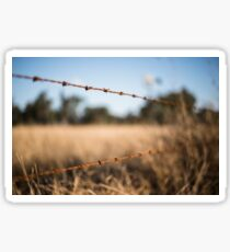 Rusted sharp timber and metal barb wire fence. Sticker