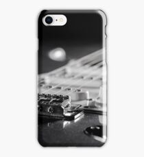 Electric guitar on wooden background, close up iPhone Case/Skin