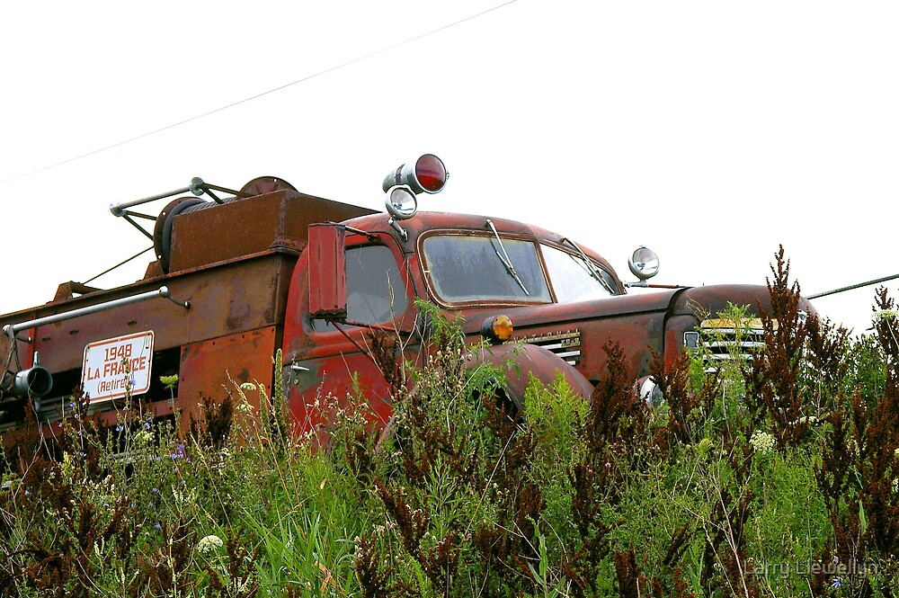 A Rusty 1948 Fire Truck  Retired..... by Larry Llewellyn