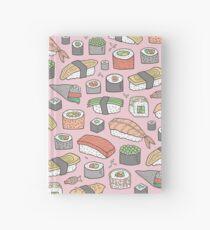 Sushi auf Rosa Notizbuch