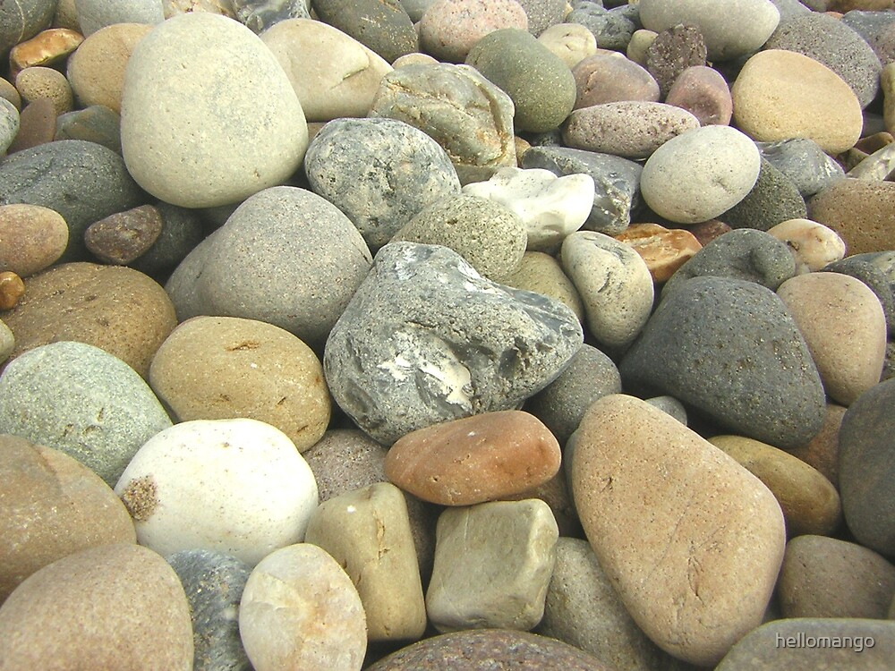 Pebbles on a beach by hellomango