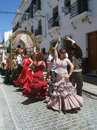 Flamenco dancers at San Isidro Parade, Nerja, Spain by chord0