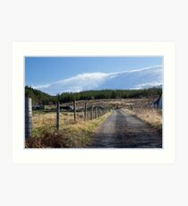 Snow blowing off the hill Art Print