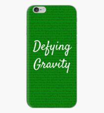 Vinilo o funda para iPhone Desafiando la gravedad