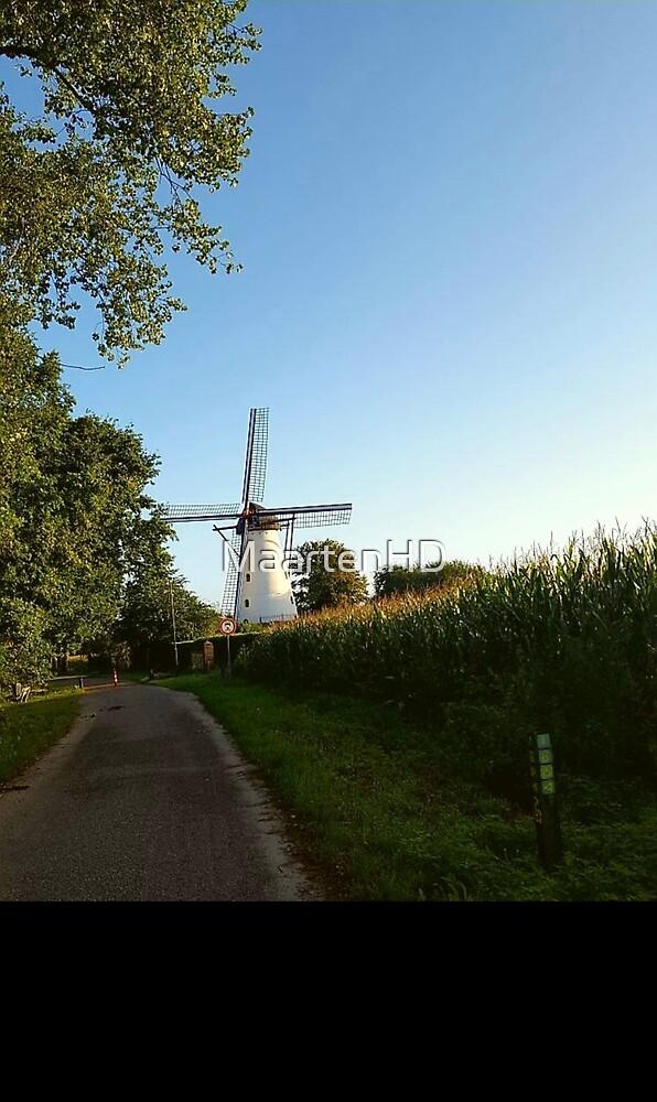 Windmill by road by MaartenHD