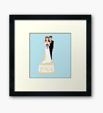 A Wedding Cake Topper Framed Print