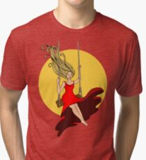girl swinging on a swing in a red dress Tri-blend T-Shirt