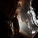 A lone caver admires the flowstone in Fairy cave. Mendip Hills. by ferret