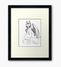 Toothless trying to hide Framed Print