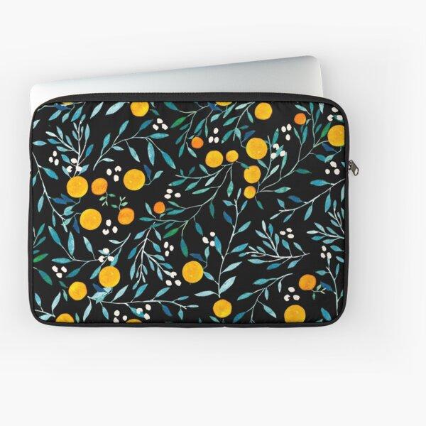 Oranges sur fond noir Housse d'ordinateur