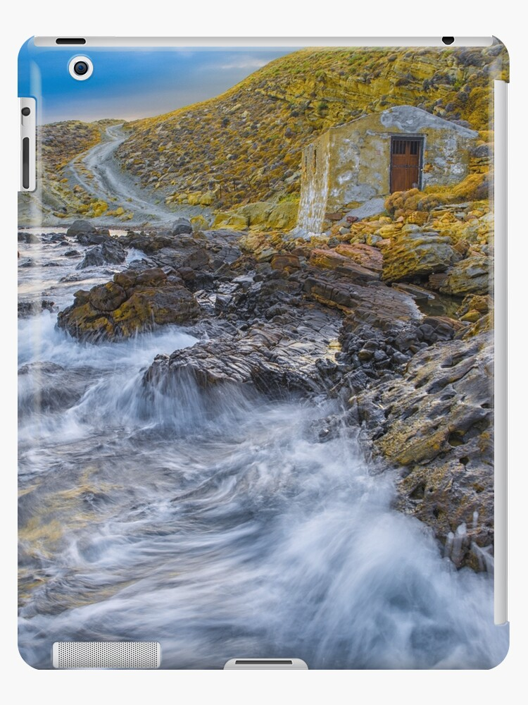 A small house close to sea rocks by hayrettinsokmen