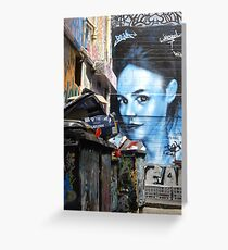 Blue girl in a sea of rubbish Greeting Card