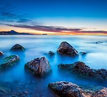 Wet rocks at dawn long exposure by Ralph Goldsmith