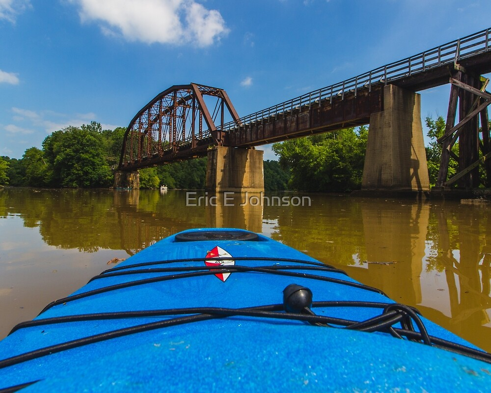 Kayaking under the rail bridge by Eric Johnson