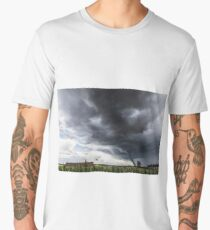 Storm tornado or twister lifing hay bales in bad weather Men's Premium T-Shirt