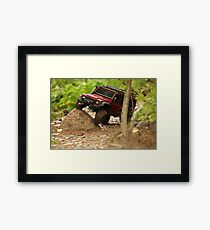 Off-road vehicle go around obstacles Framed Print